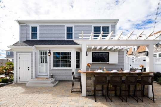 Outdoor bar is complete with flat screen TV! 5 Sea Breeze Avenue Harwich Port Cape Cod - New England Vacation Rentals