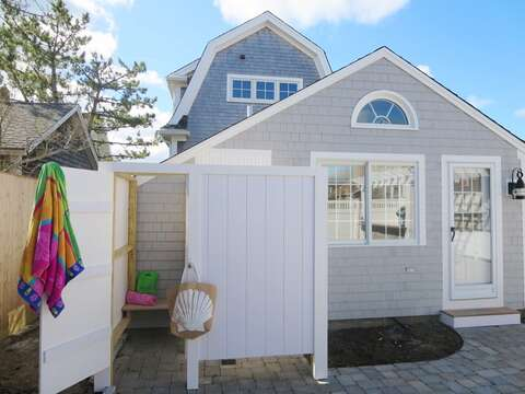 Outdoor shower -Enclosed with hot and cold water! (Garage area to the right has a changing area for you  )-5 Sea Breeze Avenue Harwich Port Cape Cod - New England Vacation Rentals