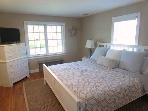 Master bedroom on 1st floor has new paint, a king bed, flat screen TV, and all new furnishings) - 5 Sea Breeze Avenue Harwich Port Cape Cod - New England Vacation Rentals