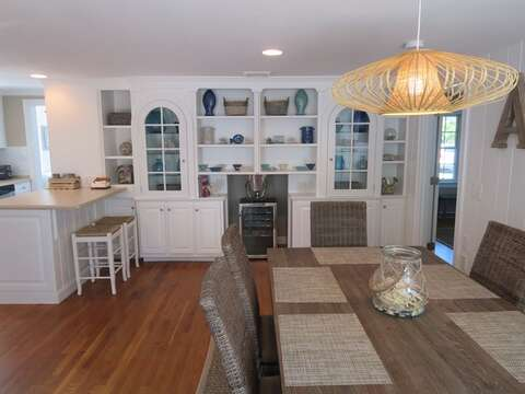 Another view of the Dining room -wine frig available for your pleasure-(off to the right is the master bedroom on the 1st floor) 5 Sea Breeze Avenue Harwich Port Cape Cod - New England Vacation Rentals