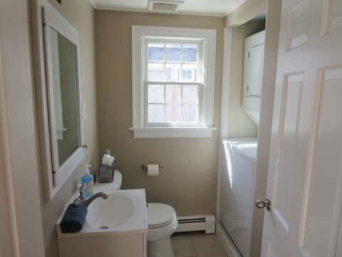 Powder room off of the kitchen includes a washer/dryer - 5 Sea Breeze Avenue Harwich Port Cape Cod - New England Vacation Rentals