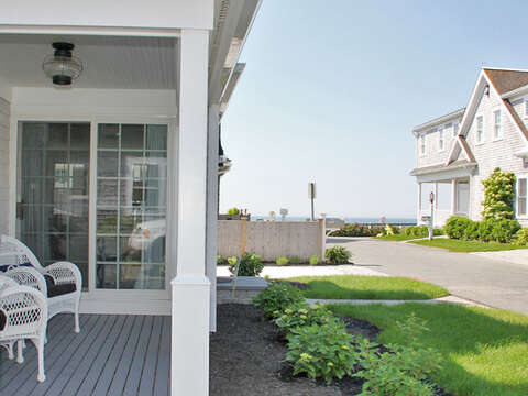 Relax on the covered porch - the beach is just 2 doors down! - 5 Sea Breeze Avenue Harwich Port Cape Cod - New England Vacation Rentals
