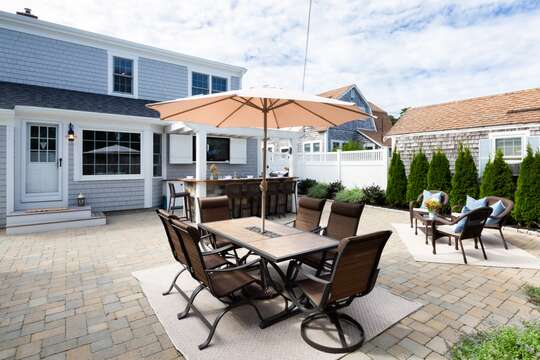 View of private back patio- fence installed -table - chairs- Gas grill- 5 Sea Breeze Avenue Harwich Port Cape Cod - New England Vacation Rentals