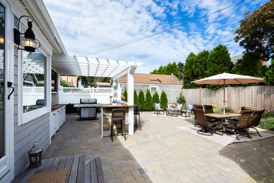 Large back patio to enjoy the outdoors! Gas Grill -table -chairs - Bar area with Flat Screen TV! - 5 Sea Breeze Avenue Harwich Port Cape Cod - New England Vacation Rentals