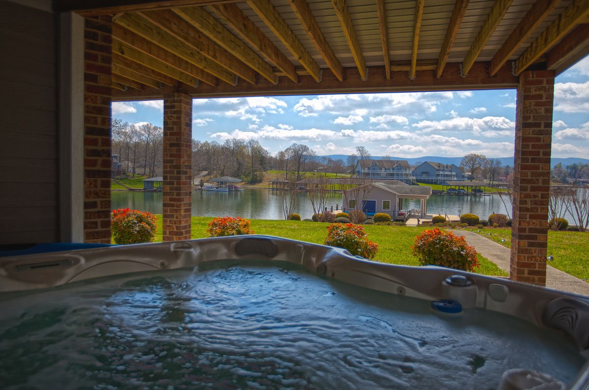 Covered Outdoor Hot Tub with Lake View