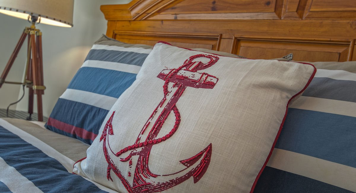 White Pillow with Red Anchor