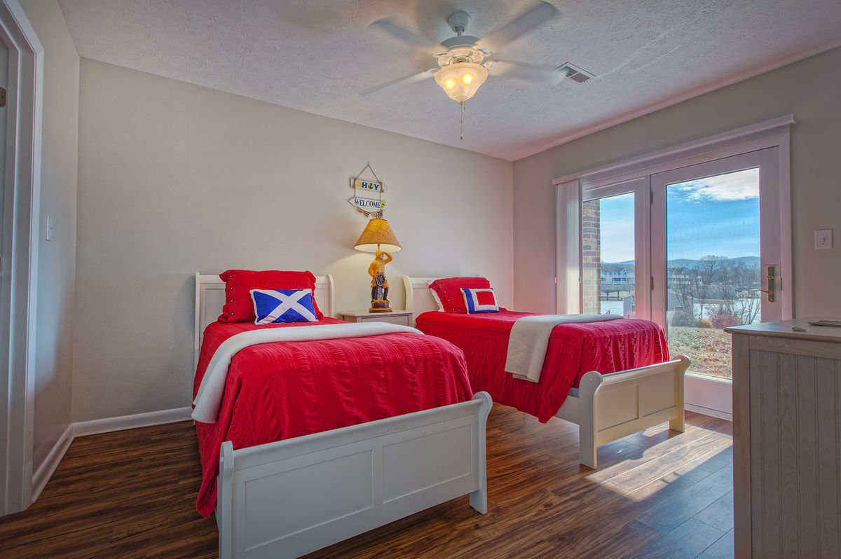 Lower Level Bedroom with two Twin Beds and Balcony access