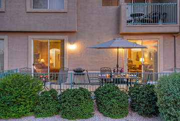 Outside view of private patio shows access points from the great room and primary suite.