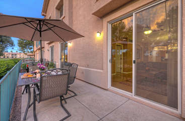 Patio provides shaded and sunny places to be charmed by the views of the golf course and community gardens.