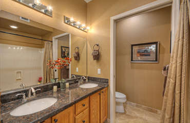 Primary bath is spacious and bright with a garden tub and shower.