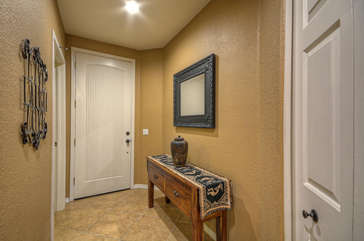 Pretty entrance foyer welcomes you to our ground floor condo.