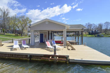 Dock and Boathouse with Lounge Chairs