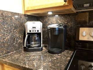 Keurig and drip coffee makers are available for the coffee connoisseur.