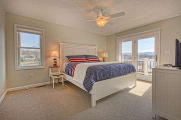 Bedroom with King Bed, Nightstand, and Ceiling Fan