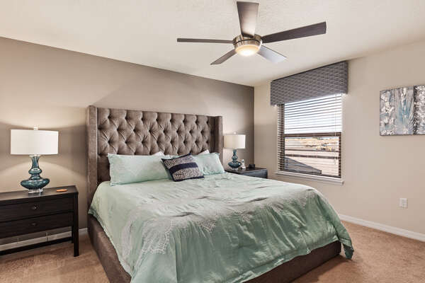 Come home to comfort with this upstairs king bedroom