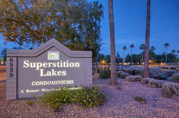 Welcome to gated waterfront neighborhood that adjoins Superstition Springs Golf Club