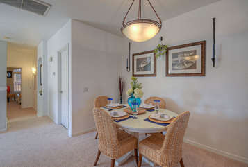Dining area is perfect for take-out from nearby restaurants or, if guests prefer, more formal meals