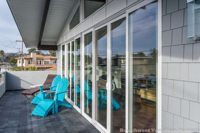 Sliding doors from great room open up to upstairs balcony