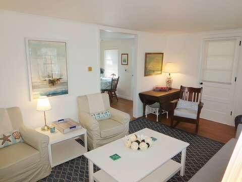 View from the living room to the kitchen and porch - 41 Whip O Will Harwich Cape Cod - New England Vacation Rentals