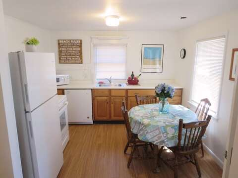 Eat in Kitchen - there is a leaf for the table so it can seat 6- 41 Whip O Will Harwich Cape Cod - New England Vacation Rentals