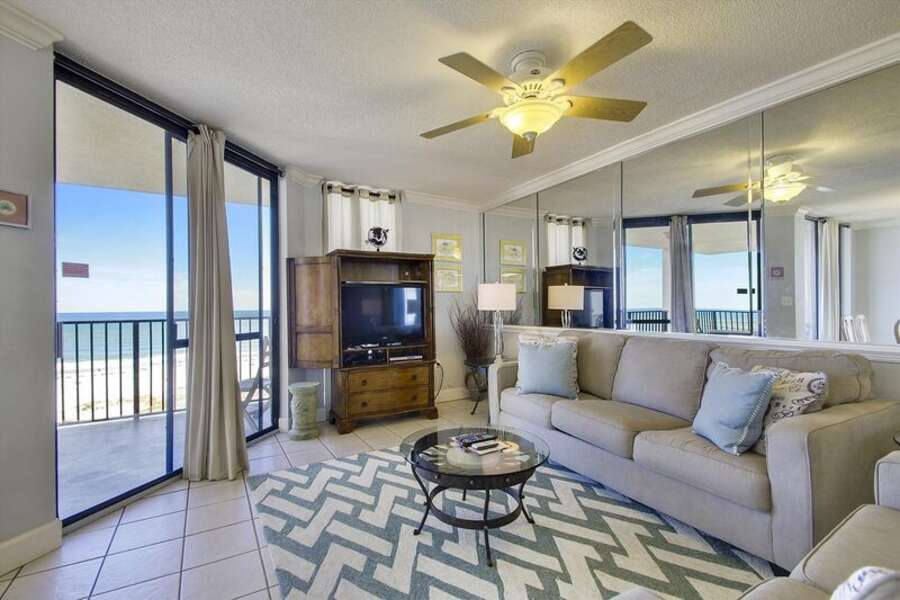 Living Area with Queen Size Sleeper Sofa and access to the Private Balcony