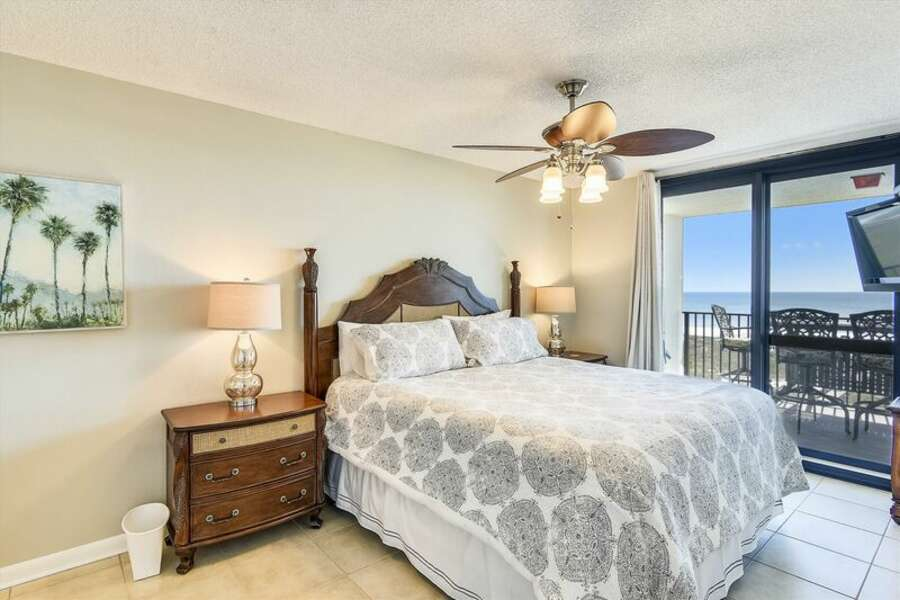 Master Bedroom has a King Size Bed and Private Balcony Access