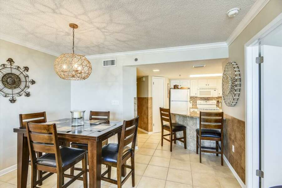 Spacious Living and Dining Areas with a Balcony View