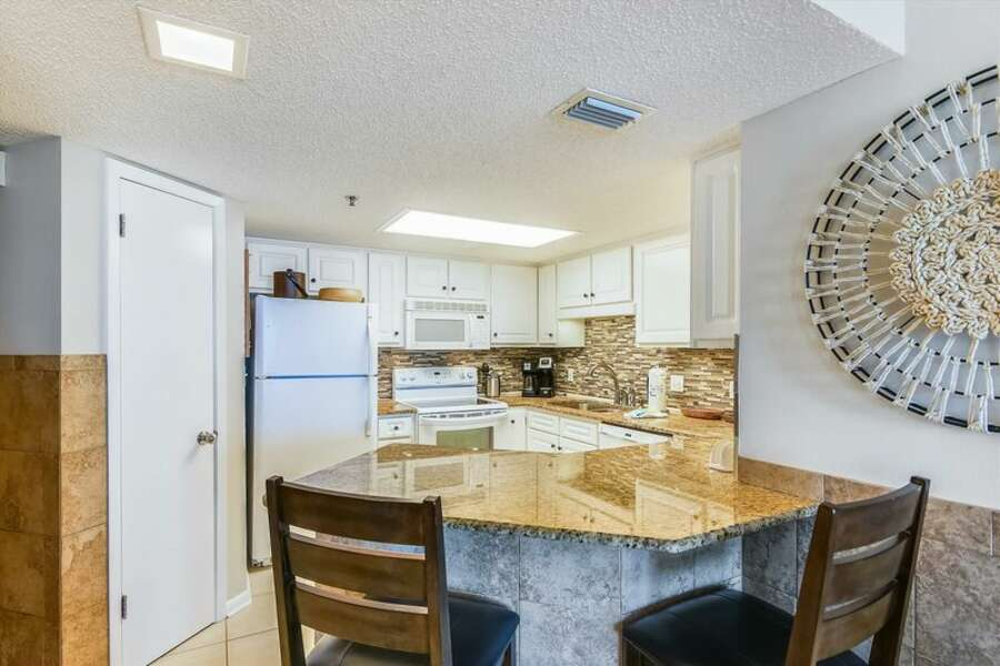 Full Size Kitchen has Upgraded Cabinets and Granite Counter Tops with a Breakfast Bar