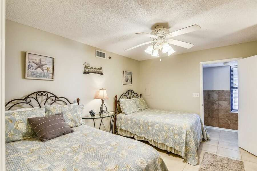 Guest Bedroom has 2 Full Size Beds and a Private Bath