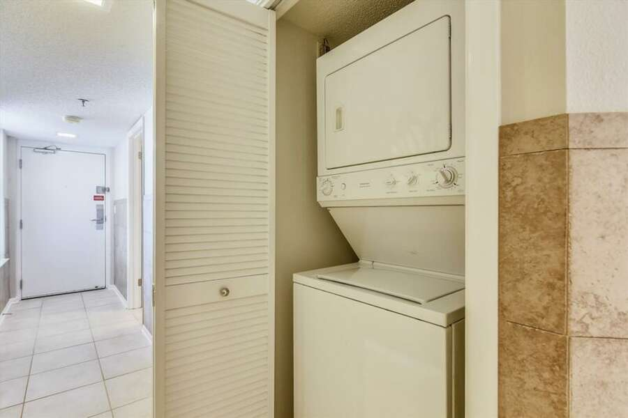 Laundry Closet with Stacked Washer and Dryer