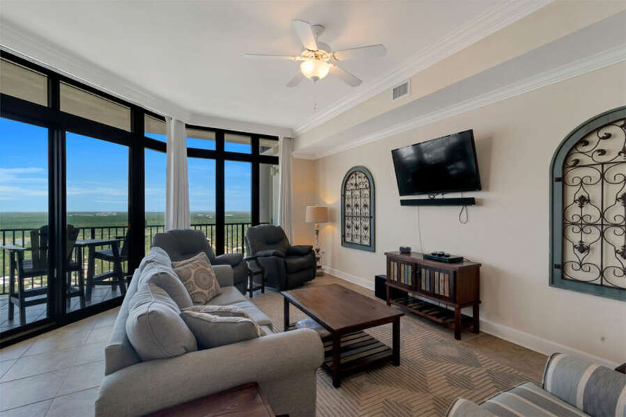 Spacious Living and Dining Areas with floor to ceiling windows reveal a fantastic view of paradise.