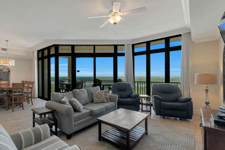 Spacious Living and Dining Areas with floor to ceiling windows reveal a fantastic view of paradise