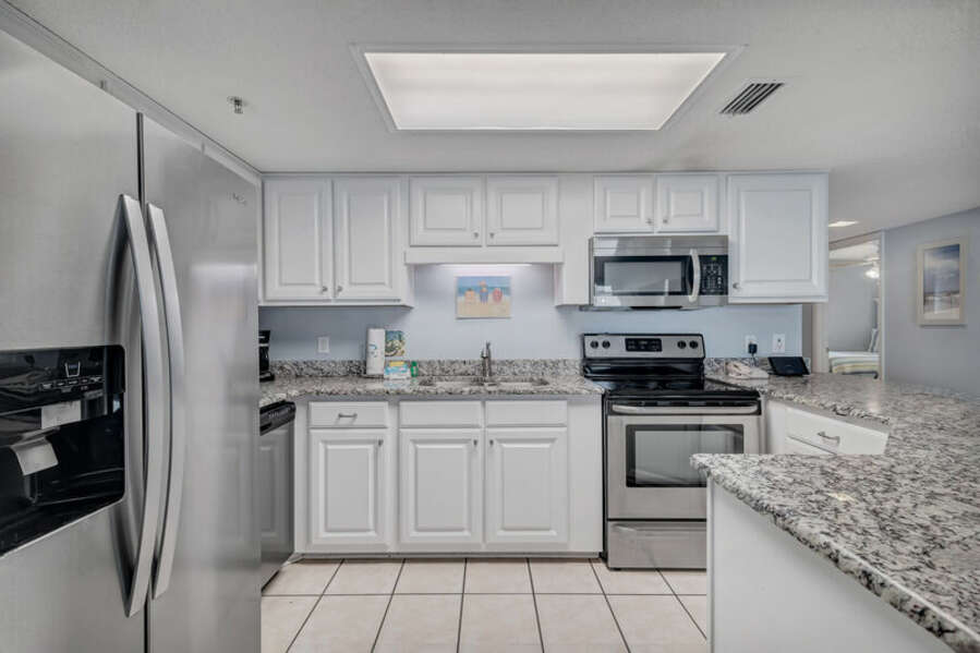 Updated Kitchen with Stainless Steel Appliances and Granite Counter Tops