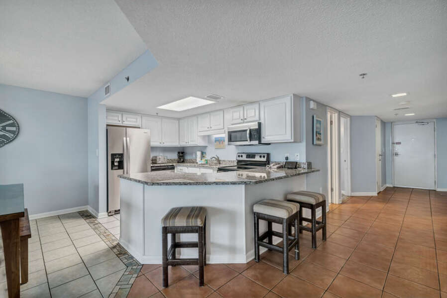 Updated Kitchen with Stainless Steel Appliances, Granite Counter Tops and Breakfast Bar