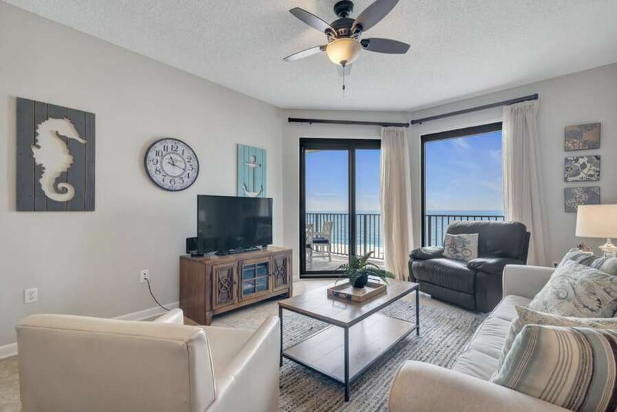 Spacious Living Room with Comfortable Seating and Balcony Access