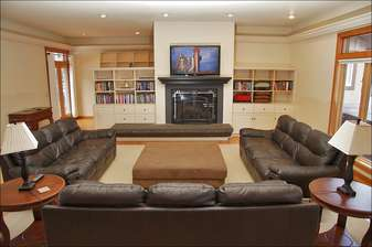 Main living room with 3 full size leather sofas