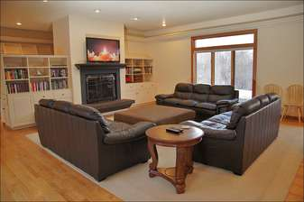 The main living room has a large HDTV and gas fireplace