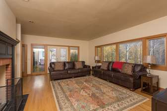 The second living room has 2 sofas and a gas fireplace