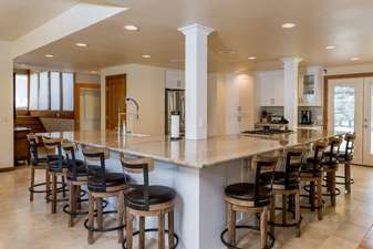 When a kitchen has bar seating for 10, you know it is big