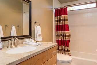 Updated full bathroom adjacent to bedrooms 6 and 7