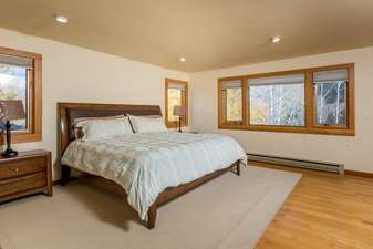 Master Bedroom 2 has a King Bed, HDTV, private bathroom, and great mountain views