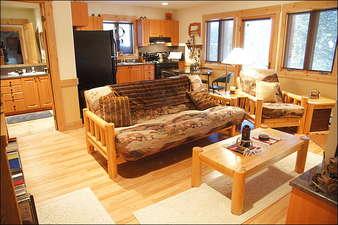 Hardwood Floors, Log Futon, & Granite Counters.