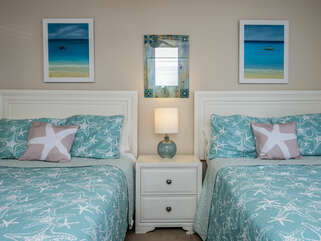 2nd bedroom on the first floor features 2 full beds and an en suite full bathroom.