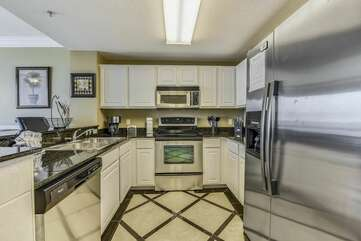 Remodeled kitchen, with beautiful stainless steel appliances, alongside other counter top appliances for use