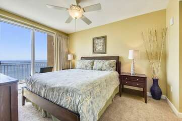 (King) Master bedroom with an entrance door to the balcony and a view of the Gulf
