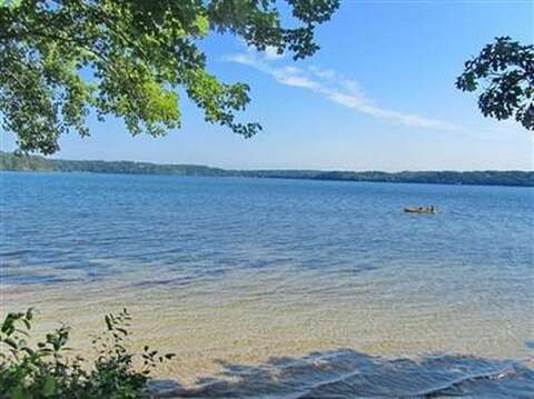 The beautiful clean pond is steps from the deck-160 Long Pond Drive Harwich Cape Cod - New England Vacation Rentals