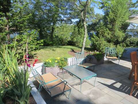 Plenty of seating and lovely gardens welcome you to the patio-160 Long Pond Drive Harwich Cape Cod - New England Vacation Rentals