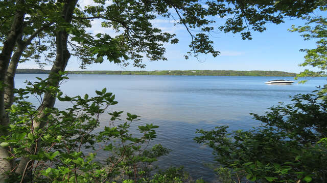Sparkling waters surround the home! 160 Long Pond Drive Harwich Cape Cod - New England Vacation Rentals