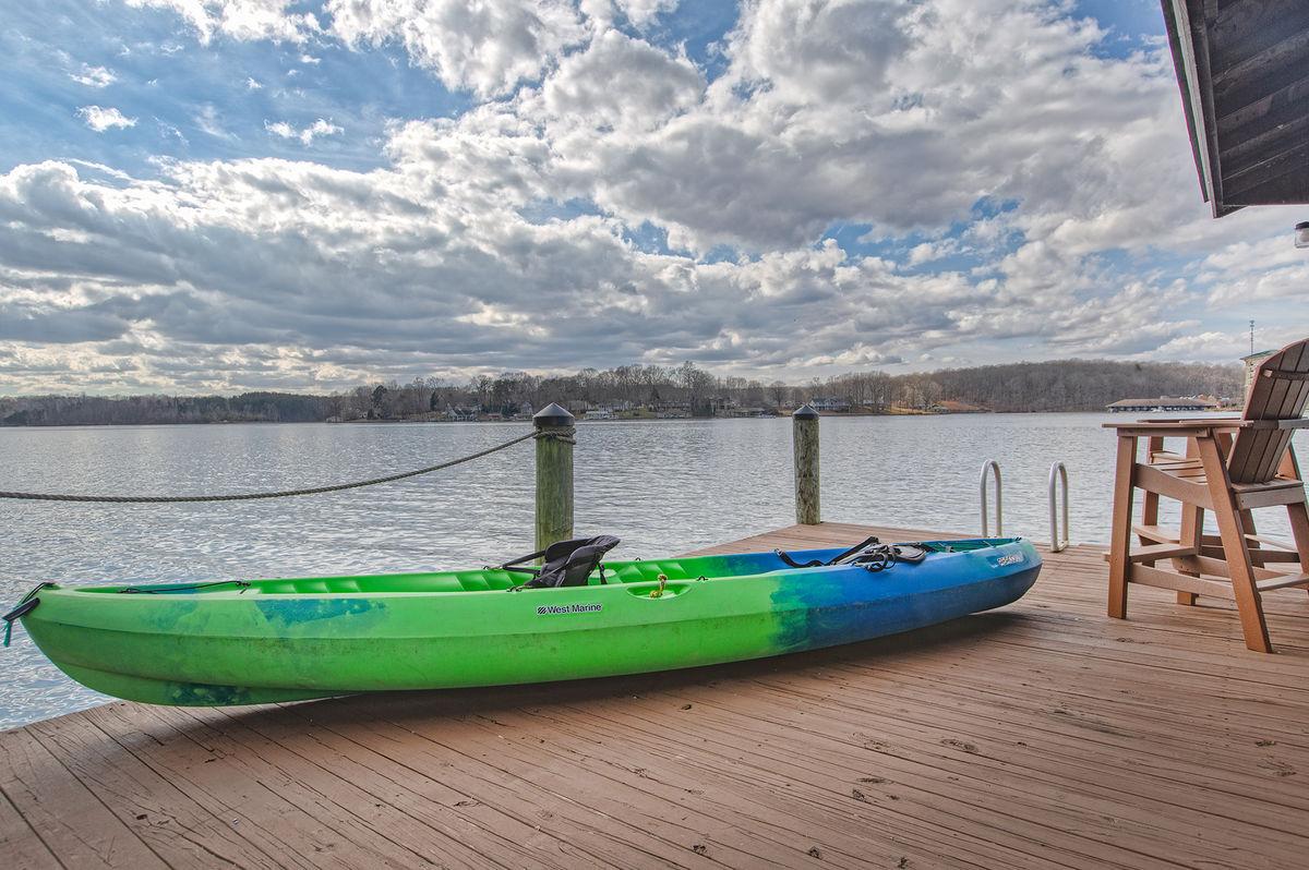 Image of Kayak on Wooden Dock.