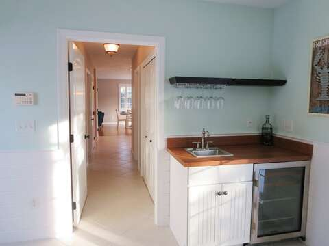 Wet bar at side entry down the hall from the kitchen - 9 Wilfin Road South Yarmouth Cape Cod - New England Vacation Rentals